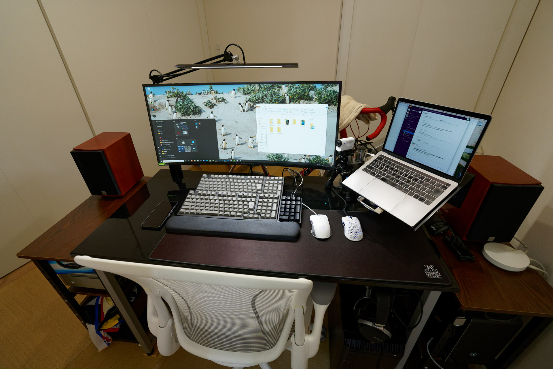 Two desktop PCs and one MacBook Pro connected to a single monitor.