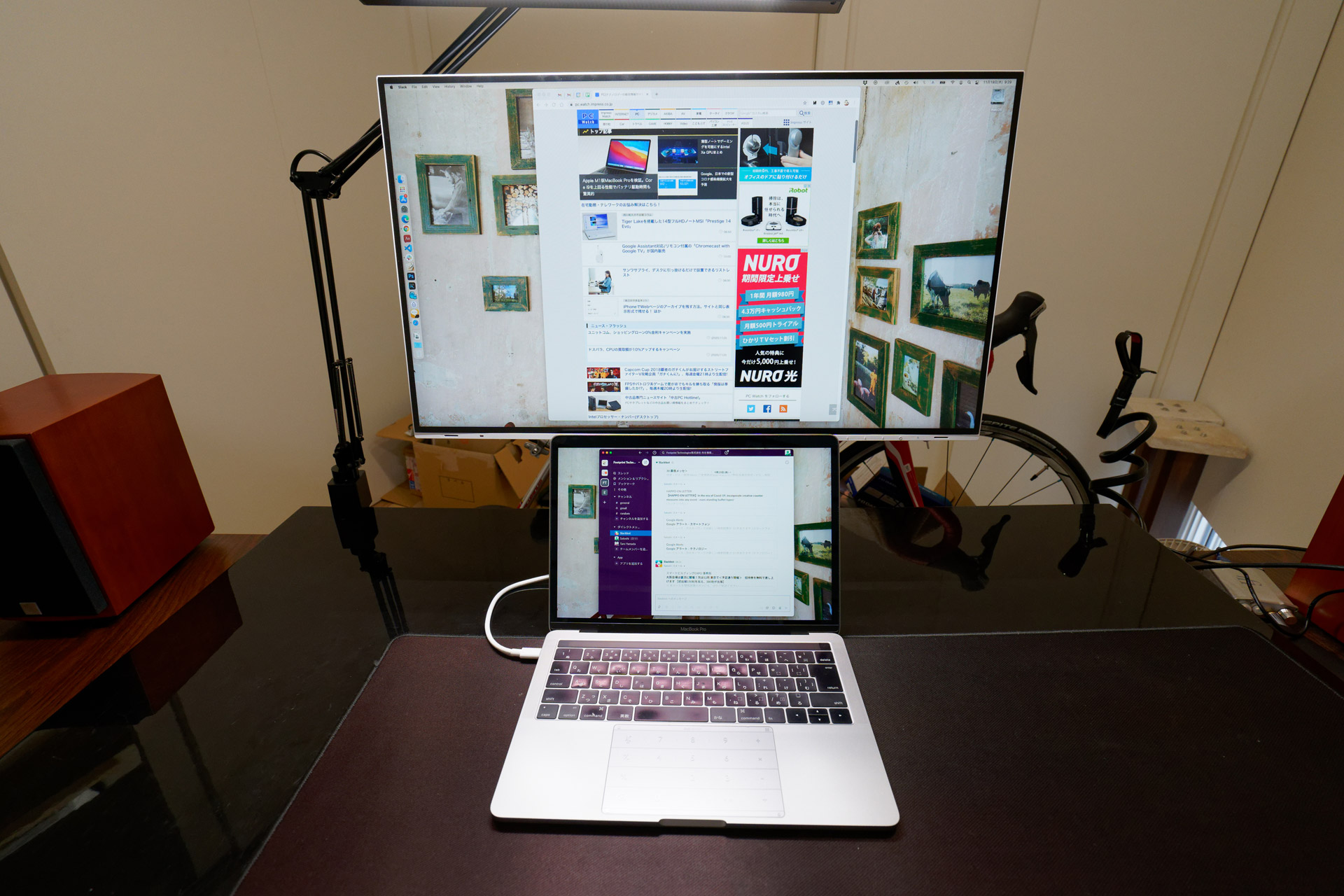 The stand's freely adjustable height makes it possible to place the 13-inch MacBook Pro underneath.